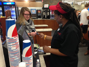 Photo by Kaye Burnet | The Duquesne Duke Takeyla Grubd charges a student for her salad at The Incline. Students can use meal swipes, cash or card to purchase combos at several locations on campus.