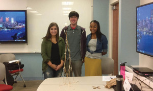 "By Gigi Jeddi | The Duquesne Duke Left to right: MBA students Ashleigh Mitchell, Mark Iaboni and Morgan Price stand with their completed teambuilding ""Marshmallow Challenge"" project."