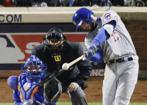 Chicago Cubs' Kris Bryant hits an RBI double during the sixth inning of Game 2 of the National League baseball championship series against the New York Mets Sunday, Oct. 18, 2015, in New York. (AP Photo/David Goldman)