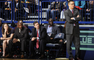 Courtesy of AD - Dan Burt and the rest of his staff look on during one of their matchups last season. Burt hopes to coach his squad to its eighth straight winning campaign.