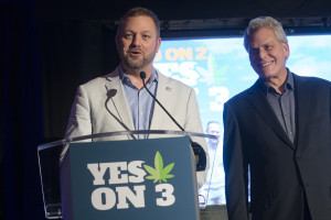 Ian James, executive director of ResponsibleOhio, a pro-marijuana legalization group, gives a concession speech to the crowd alongside co-founder Jimmy Gould, right, at an election night event at the Le Meridien hotel, Tuesday, Nov. 3, 2015, in Columbus, Ohio. Voters have rejected a ballot measure that would have made Ohio the first state to make marijuana legal for both recreational and medical use in a single stroke. (AP Photo/John Minchillo)