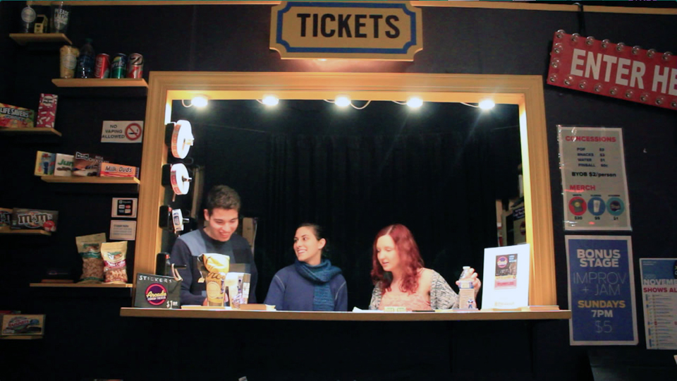 Photo by Julian Routh | Editor in Chief. Three students of the Arcade sell tickets to a Sunday night show.