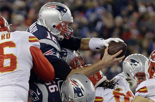AP Photo - New England Patriots quarterback Tom Brady (12) goes over the top for a touchdown against the Kansas City Chiefs in the first half of an NFL divisional playoff football game, Saturday, Jan. 16, 2016, in Foxborough, Mass.