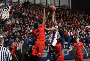 Courtesy of Athletic Department - Junior forward Darius Lewis shoots a fade away against the University of Dayton.