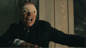 "Courtesy of Human World Wide Studios Bowie wears a cloth mask in the music video for ""Lazarus,"" one of the songs featured on ""Blackstar."" The song deals with the theme of ressurection."