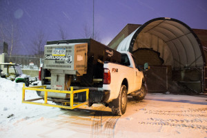 Photo by Seth Culp-Ressler | Features Editor. Jeff Henks gives his plow truck a break Saturday to load up on salt.