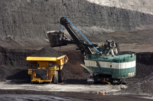 AP — In this April 4, 2013 file photo, a mechanized shovel loads coal onto a haul truck at the Cloud Peak Energy's Spring Creek mine near Decker, Mont.