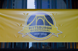 By Joseph Guzy | Photo Editor A banner hanging downtown draws attention to Pittsburgh's bicentennial celebration. The city has several events planned for 2016 to commemorate the founding.