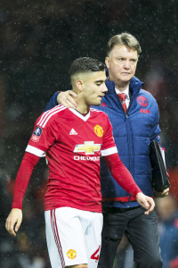 Manchester United's manager Louis van Gaal, right, walks from the pitch with Andreas Pereira after the English FA Cup third round soccer match between Manchester United and Sheffield United at Old Trafford Stadium, Manchester, England, Saturday Jan. 9, 2016. (AP Photo/Jon Super)