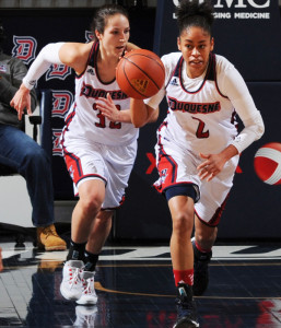 Courtesy of the Athletic Department - Deva'Nyar Workman carries the ball up court with fellow senior April Robinson during the Dukes' 84-81 loss against Saint Louis last Thursday. Duquesne has one game left on its schedule before A-10's.