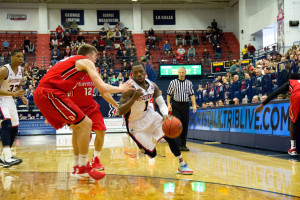 By Bryanna McDermott | The Duquesne Duke - Senior guard Derrick Colter drives the lane against a defender during the Dukes' 93-82 loss against Davidson last Saturday afternoon at Palumbo.
