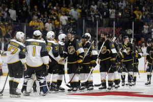 Pacific Division players, right, shake hands with Atlantic Division players following the NHL hockey All-Star championship game Sunday, Jan. 31, 2016, in Nashville, Tenn. The Pacific Division won 1-0.