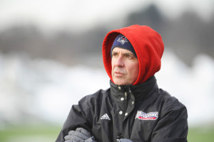 Courtesy of the Athletic Department - Duquesne's lacrosse head coach Mike Scerbo scans the pitch during a 2015 matchup. Scerbo is in his 10th season at the helm of the lacrosse program. Last season Scerbo led his squad to a 9-9 overall record.