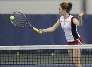 Courtesy of the Athletic Department - Senior Alexa Miller defends a shot during a 2015 singles match. The women's tennis team defeated Carnegie Mellon 4-3 last Friday night while the men's team lost to Binghamton.