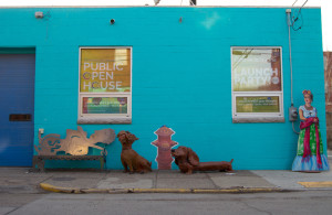 Photo by Joseph Guzy | Photo Editor. Two clay dogs decorate the outside of a building Wednesday in Uptown where local city leaders met in February to talk about strategies to improve the neighborhood. Uptown is home to Duquesne University, Mercy Hospital, and more than 800 residents.