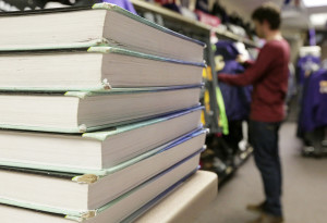 Textbooks are stacked at Illinois Valley Community College. Sometimes, dropping a class is a viable option for students who are stressed, in financial trouble or face a number of other scenarios.