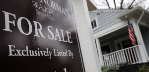 "In this Tuesday, Jan. 26, 2016, photo, a ""For Sale"" sign hangs in front of an existing home in Atlanta. On Thursday, Feb. 25, 2016, Freddie Mac reports on the week's average U.S. mortgage rates. (AP Photo/John Bazemore)"