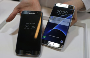 FILE - In this Sunday, Feb. 21, 2016, file photo, a Samsung Galaxy S7, left, and S7 Edge are displayed during the Samsung Galaxy Unpacked 2016 event on the eve of the Mobile World Congress wireless show, in Barcelona, Spain. Samsung's phone cameras have shown tremendous improvements in just a few years. The new Galaxy S7 and S7 Edge phones take better pictures than last year's S6 models. They are neck and neck with Apple's iPhones, such that you no longer have to compromise on picture quality if you prefer Android. (AP Photo/Manu Fernadez, File)