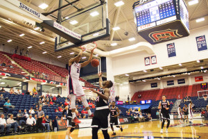 By Bryanna McDermott   The Duquesne Duke - Sophomore forward Eric James dunks over a Nebraska-Omaha player during the Dukes' 120-112 win over the Mavericks Wednesday night. With the victory, the Dukes will go on to play Morehead St.