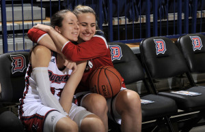 Courtesy of the Athletic Department - Freshman forward Eniko Kuttor hugs senior guard April Robinson after defeating LaSalle in their penultimate matchup of the 2015-16 season. The Dukes will find out Monday if they have made the tourney.