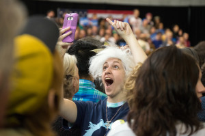 Photo by Joseph Guzy | Photo Editor. An excited, wig-laden Sanders supporter takes a selfie at the senator's Pittsburgh rally last Thursday.