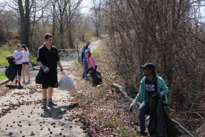 Courtesy of Gretchen Pratt Duquesne students pick up trash along a road for the 2014 Spiritan Campus Ministry Spring Clean-Up. This year, almost 600 students will travel to the Hill District, Uptown and the South Side. They will be joined by 100 community members.
