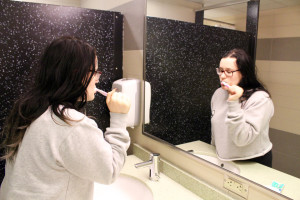 A Duquesne student Annie McHone brushes her teeth in her dormitory. The PWSA recently gave Duquesne's water a clean bill of health when it comes to lead content.