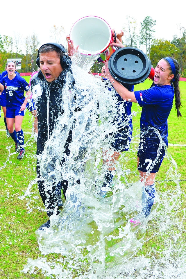 Courtesy of the Athletic Department. Coach Al Alvine gets showered in gatorade by his team after last year's Atlantic 10 Championship winning game. Alvine's contract has been renewed through the 2020-2021 season.