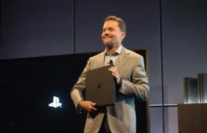 Courtesy of Forbes President of Sony Interactive Entertainment Andrew House stands-on stage with the PlayStation 4 Pro at the console's announcement. It has been criticized for its lack of features compared to the Xbox One S.