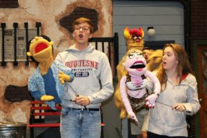 "Sydney Bauer/Staff Photographer Red Masquers members practice with their puppets for ""Avenue Q."" The show is heavily influenced by children's programs such as ""Sesame Street"" and ""The Muppets,"" and as such, features plenty of puppets."