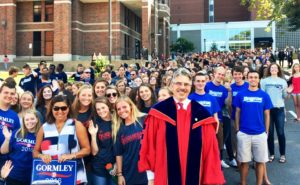 Kailey Love | Photo Editor  President Gormley stands in front of a mass of Duquesne students including members of the Duquesne lacrosse and Duquesne track and field teams.
