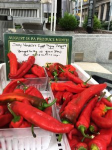 Photo by Kailey Love | Photo Editor. Cartons of sweet red peppers are offered by a vendor at the Mellon Square Citipark Farmers' Market last Friday.