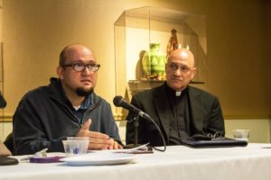 Sydney Bauer/Staff Photographer  Communications professor John Rief and Rev. John Sawicki at the panel Monday.
