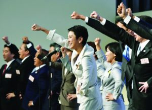 Newly elected Democratic Party leader Renho Murata, center, raises her clenched fist with other party lawmakers upon her election in Tokyo Thursday, Sept. 15, 2016. Murata, who generally goes by only her first name, is a woman, one of three who have assumed prominent political posts in recent weeks in a country more known for its male-dominated political and business hierarchy. Her election Thursday followed that of Tokyo's first female leader on July 31, and the appointment of a woman as defense minister later the same week. (Shigeyuki Inakuma/Kyodo News via AP)