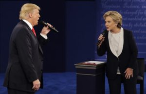 AP Photo FILE - In this Sunday, Oct. 9, 2016, file photo, Republican presidential nominee Donald Trump and Democratic presidential nominee Hillary Clinton speak during the second presidential debate at Washington University in St. Louis. Trump gets outsized attention for what he's tweeting and retweeting on a near-daily basis. But Clinton has a formidable digital media army, her own app and a rapid response team ready to blast out shareable soundbites from convention speeches, photos, videos and even temporary location-specific Snapchat filters mocking Republicans. (AP Photo/John Locher, File)