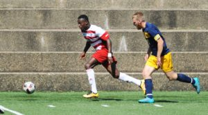 Courtesy of Duquesne Athletics Freshman forward Jallah Acqui goes for goal against the Canisius Golden Griffins in a mid-September non-conference matchup. Acqui currently has one goal and one assist on the young 2016 season.