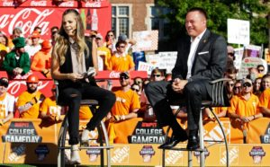 Tennessee head coach Butch Jones, right, talks with ESPN host Samantha Ponder on the Gameday set before an NCAA college football game against Florida Saturday, Sept. 24, 2016, in Knoxville, Tenn. (AP Photo/Wade Payne)