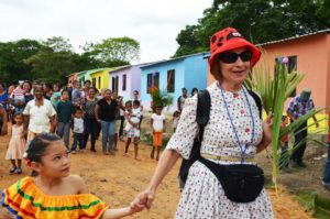 Courtesy of Food for the Poor Maria Sawick walks with a young girl in Jicaro, Nicaragua, where a school was dedicated in her late daughter Sara's honor in June. Sawick and her friends raised money for the school, which was built by Food For The Poor.