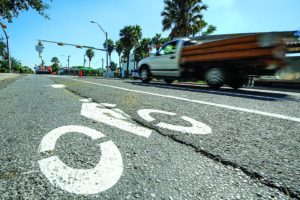 AP Photo Traffic flows along 7th Street, Tuesday, Oct. 4, 2016, in Brownsville, Texas. Traffic flow has been reduced to two lanes as city crews install a new bike path along the downtown street. (Jason Hoekema/The Brownsville Herald via AP)