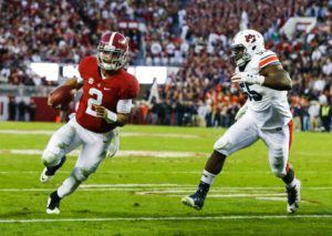 Alabama quarterback Jalen Hurts (2) scrambles past Auburn defensive lineman Carl Lawson (55) and runs in for a touchdown during the first half of the Iron Bowl NCAA college football game, Saturday, Nov. 26, 2016, in Tuscaloosa, Ala. (AP Photo/Butch Dill)