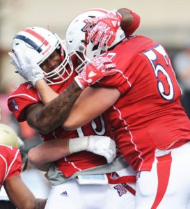 Photo Courtesy of Duquesne Athletics  Graduate student and wide receiver Blair Roberts celebrates with his offensive lineman Matt Fitzpatrick after scoring one of his school-record four touchdowns in the 35-31 win over Bryant on Saturday.