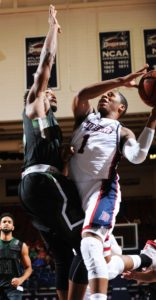 Courtesy of Duquesne Athletics Freshman guard Mike Lewis II drives to the basket against Loyola (MD) on Nov. 11 at the A.J. Palumbo Center. Mike Lewis is averaging 9.0 points per game three games into his rookie season.