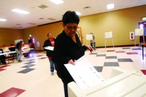 Unlike the voter pictured here in New Mexico, those voting in Maine will soon be able to rank candidates on the ballot so that election results are fairer.