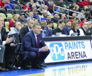Bry McDermott | Asst. Photo Editor Head coach Jim Ferry looks on as his team struggles in a 76-57 loss to the University of Dayton Flyers at PPG Paints Arena on January 14. The loss pushed the Red & Blue to 9-9 on the season.