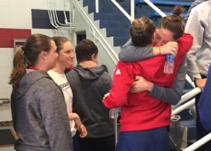 Kaye Burnet |Editor-in-ChiefTwo Duquesne swimmers embrace after a press conference Jan 10, five days after the Fort Lauderdale airport shooting.