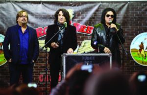 "Paul Stanley, center, and Gene Simmons of KISS speak during a during a press conference for the ground breaking of their ""Rock and Brews Casino Resort"" in Braman, Okla., Jan. 12, 2017. (Jessie Wardarski/Tulsa World via AP)"