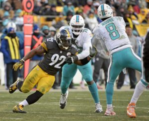 Pittsburgh Steelers outside linebacker James Harrison (92) pressures Miami Dolphins quarterback Matt Moore (8) during the second half of an AFC Wild Card NFL football game in Pittsburgh, Sunday, Jan. 8, 2017. (AP Photo/Fred Vuich)