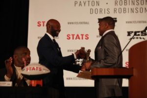 Freshman running back A.J. Hines receives the FCS STATS Jerry Rice Award from Jerry Rice himself at the awards banquet in Frisco, Texas on Jan 6. The award is given to the top freshman at the FCS level.