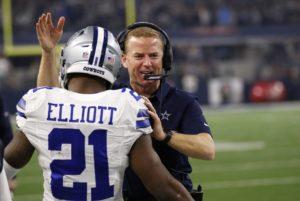 Dallas Cowboys' Ezekiel Elliott (21) and head coach Jason Garrett celebrate during an NFL football game against the Detroit Lions on Monday, Dec. 26, 2016, in Arlington, Texas. (AP Photo/Roger Steinman)