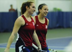 Courtesy of Duquesne Athletics | Doubles partners Kylie Isaacs, junior, and Julianne Herman, sophomore, get ready to shake hands with  opponents after their doubles win on April 6, 2016. The pair will look to continue their success in 2016-17.